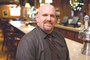 Larry Boyd, 43, now works as the Front house manager at Shanty Grille.