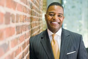 Calvin Butler, Exelon's senior vice president for corporate affairs, is living in Baltimore part-time until the merger closes.