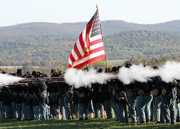 A living-history demonstration at Antietam National Battlefield. Civil War re-enactments are expected to draw up to 200,000 visitors to the state.