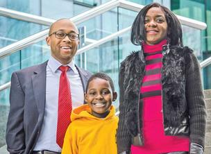 "DLA Piper LLP attorney Jamaal ""Jay"" Stafford, left, helped Kaneka Malone retrieve her son, Chevor Malone Jr."
