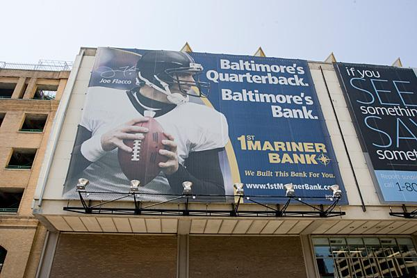 This large billboard advertisement for First Mariner Bank features Ravens quarterback Joe Flacco on First Mariner Arena downtown.