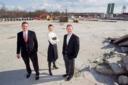 George Carras, of StonebridgeCarras; Michael Hancock, of Bozzuto Group; and Jeffrey Kayce of Bozzuto Group, stand on the future site of Flats170 in Odenton.