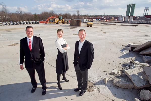 George Carras, of StonebridgeCarras, Michela Hancock, of Bozzuto Group, and Jeffrey Kayce of Bozzuto Group, stand on the future site of Flats170 in Odenton.