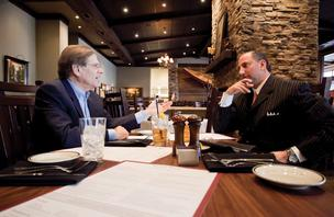 Michael Hodes, left, a proponent of power lunches with Hodes, Pessin & Katz, P.A., talks business with Kent Pearce of Merrill Lynch Wealth Management at Stoney River in Towson.