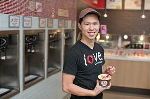 Sam Liu, 27, left his career as a financial analyst and opened a Red Mango yogurt shop in Clarksville.