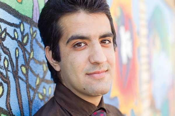 Sina Navazi, caseworker with the International Rescue Committee, uses his experience as an Iranian refugee to help others who come to the committee for assistance.