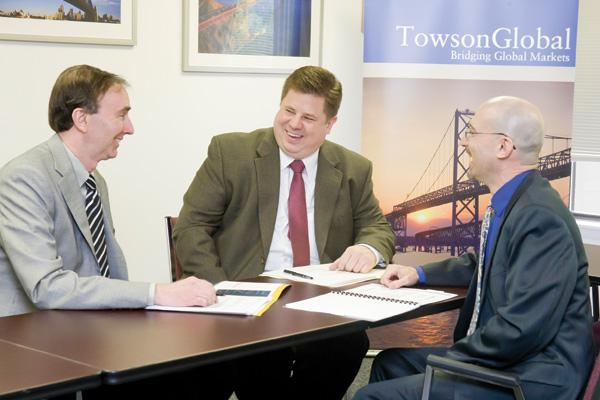 From left, David Ryan and Jacques Dompier of Chesapeake Compensation Solutions credit much of their firm's success to participating in Towson University's business incubator, TowsonGlobal, whose director is Clay Hickson (right).