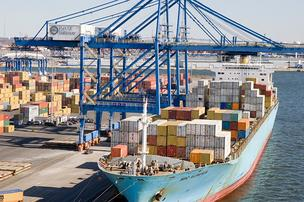 A container ship calling on the Port of Baltimore's Seagirt Marine Terminal unloads cargo in March 2009. Container business hit a record in 2011.