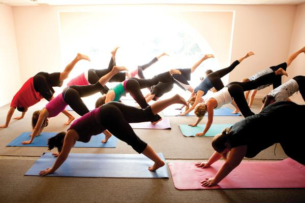 On-site yoga sessions are among benefits the Silberstein Insurance Group offers to keep employees well.