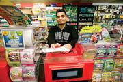 Store clerk Kenny Patel mans the lottery station at Soda Pop Shop No. 8.