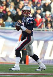 2. Tom Brady (above), Bill Belicheck and Robert Kraft's New England Patriots are worth $1.64 billion.
