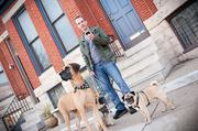Dan Tracy, of Dog Day Afternoon, banks as he walks dogs for a living.