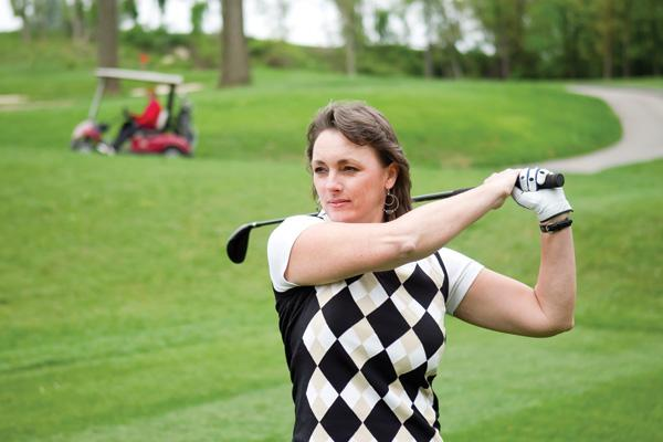 Sharon Waller, of SC&H Group, shows off her swing at Fox Hollow Golf Course.
