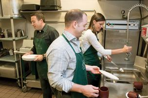 Jeremy Steinberg [left to right], Joe Mechlinski and Misti Aaronson help in the kitchen as volunteers for the Our Daily Bread hot meal program.