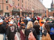 Fans lined up along the Eutaw Street entrance as early as 3:15 p.m. for the scheduled 6:15 p.m. start of the game.