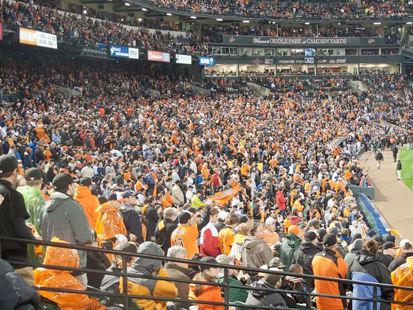 Fans cheer the Orioles as the team hosts its first home playoff game since 1997 on Oct. 7.