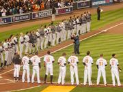 The New York Yankees and Baltimore Orioles line the field on Sunday before the first pitch of the American League Division Series.