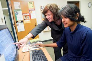 UMBC's Anne Scholl-Fiedler helps Joanne Croos with her job search.