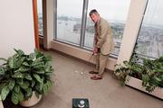 Alan Grochal, of Tydings & Rosenberg, shows his putting prowess.