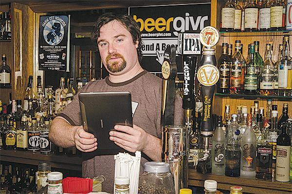 John Reusing, the owner of the Bad Decisions bar in Fells Point, said his bar began accepting bitcoins Friday.