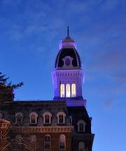 Gibbons Hall at Notre Dame of Maryland University in Baltimore glows purple.