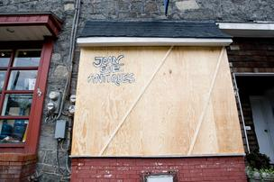 Some shops in Historic Ellicott City remained boarded up on Tuesday, while others opened in the aftermath of Hurricane Sandy.