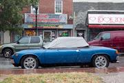 A car owner in Fells Point takes extra precaution to protect the vehicle from Hurricane Sandy.