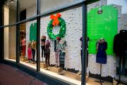 J. Crew in Harbor East combined high-end fashion and Christmas wreaths.