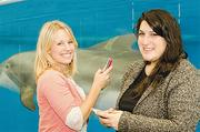 Best Business Twitter: National Aquarium in BaltimoreKate Hendrickson, left, and Nabila Chami are the faces behind the attraction's tweets.