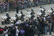 Members of the Baltimore Police Department escort lead the Ravens down the parade route.