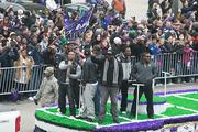 Running back Ray Rice raising the purple flag of victory.