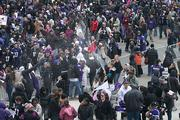 Fans started popping the bubbly as the parade made its way to M&T Bank Stadium.