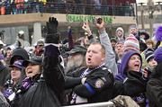 Fans cheer as the Ravens arrive at the Inner Harbor on Monday for a rally before boarding a plane to New Orleans for the Super Bowl.