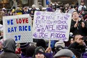 Fans hold up signs at a Ravens Super Bowl sendoff rally on Monday.