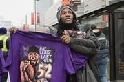 Ravens merchandise has been hot sellers during the team's playoffs run. Above, a man sells a Ray Lewis T-shirt outside the 1 E. Pratt St. office building.