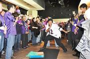 Employees inside the First Mariner Tower in Canton participated Friday in Ravens rally, which included a Ray Lewis dance contest.