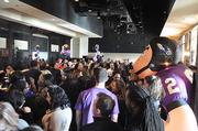 Employees inside the First Mariner Tower in Canton participated Friday in Ravens rally,