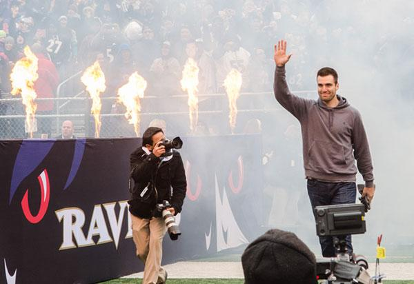 Ravens quarterback Joe Flacco is introduced to the capacity crowd at M&T Bank Stadium during the team's Super Bowl victory parade.