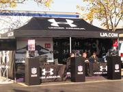 """Most of the Ravens top corporate sponsors have booths at the end of Ravens Walk near M&T Bank Stadium. Under Armour is there, as are Verizon, M&T Bank and the Maryland Lottery. The goal, Burchell said, is to get fans thinking a little business. """"As part of our gameday experience, we connect fans and corporate partners from the city to the stadium,"""" Burchell said."""