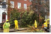 Workers clear away debris in Federal Hill