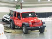 """Visitors to Baltimore's car show could take test drives in about 50 cars, including a number of different Jeep models at """"Camp Jeep,"""" where drivers could test out rough terrain and see how the cars handled inclines."""