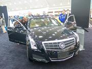 The 2013 Cadillac ATS starts at $33,990. Options in this model — including a touchscreen — brought the cost of the car on display up to $54,950.