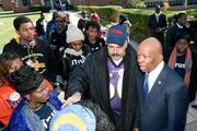 Del. Curt Anderson, left, and U.S. Rep. Elijah Cummings talk to Morgan State University students on Tuesday outside a polling site at Northwood Elementary School.