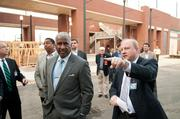 Birmingham Mayor William Bell and officials tour the entertainment district, which will include a Todd English PUB, Octane Coffee Co. and a Texas de Brazil steakhouse.