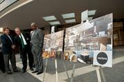Birmingham Mayor William Bell and other officials look at renderings of the latest tenants to sign on.