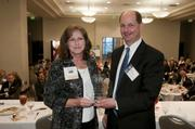 Alden Systems' Barbara Warren accepts her award from Ogletree Deakins' James Pennington.