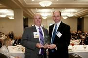 Doug Daen of Children's of Alabama accepts his award from Ogletree Deakins' James Pennington.