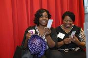 Attendees enjoy the photo gallery at the event.