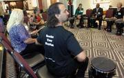 John Scalici of Get Rhythm presented a drum circle team-building exercise.