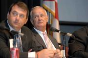 Troy Wayman and Bill Taylor listen to a question from the moderator.
